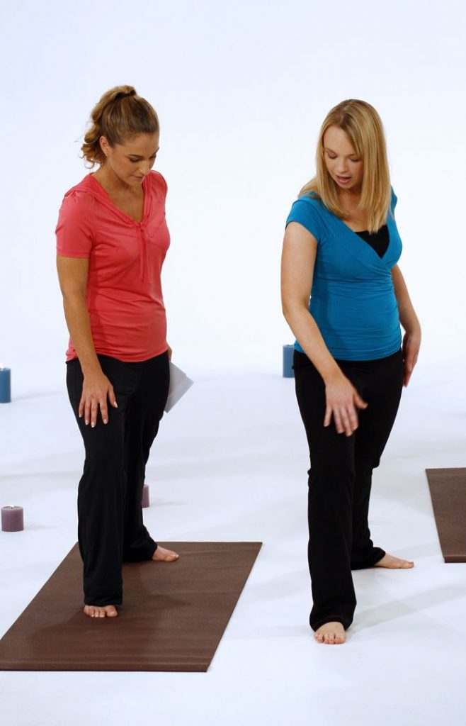 yoga instructor showing someone how to do a pose from hyp-yoga.com